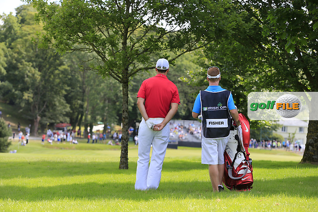 Ross Fisher (ENG) waits to play his 2nd shot from the rough on the 9th hole during Sunday's Final Round of the 2014 Irish Open held at Fota Island Resort, Cork, Ireland. 22nd June 2014.<br /> Picture: Eoin Clarke www.golffile.ie