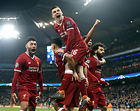 Liverpool's Mohamed Salah (right) celebrates with team mates after scoring his side's equalising goal to make the score 1 - 1<br /> <br /> Photographer Rich Linley/CameraSport<br /> <br /> UEFA Champions League Quarter-Final Second Leg - Manchester City v Liverpool - Tuesday 10th April 2018 - The Etihad - Manchester<br />  <br /> World Copyright &copy; 2017 CameraSport. All rights reserved. 43 Linden Ave. Countesthorpe. Leicester. England. LE8 5PG - Tel: +44 (0) 116 277 4147 - admin@camerasport.com - www.camerasport.com