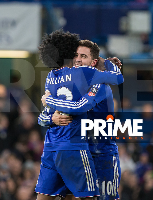 Willian of Chelsea congratulates goal scorer Eden Hazard of Chelsea during the FA Cup 5th round match between Chelsea and Manchester City at Stamford Bridge, London, England on 21 February 2016. Photo by Andy Rowland.
