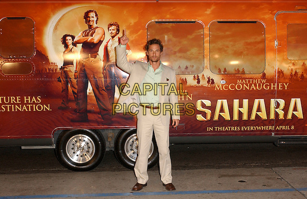 """MATTHEW McCONAUGHEY.Attends Paramount Pictures' Los Angeles Premiere of """"Sahara"""" held at The Grauman's Chinese Theatre in Hollywood, Los Angeles, California, USA,.April 4th 2005..full length poster bus beige cream suit pointing.Ref: DVS.www.capitalpictures.com.sales@capitalpictures.com.©Debbie VanStory/Capital Pictures"""