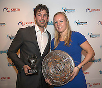 Amsterdam, Netherlands, December 12, 2016, Harbour Club, Tennisser van het Jaar,  Robin Haase receives the Richard Krajicek penning and Kiki Bertens the Betty Stove bokaal for best tennis player off yhe year.<br /> Photo: Tennisimages/Henk Koster
