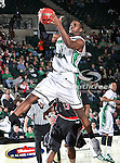 North Texas Mean Green forward George Odufuwa (4) grabs a rebound  during the NCAA  basketball game between the Arkansas State Red Wolves and the University of North Texas Mean Green at the North Texas Coliseum,the Super Pit, in Denton, Texas. UNT defeated Arkansas State 83 to 64..