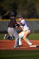 Dartmouth Big Green first baseman Michael Ketchmark (27) stretches for a throw as Jared Baldinelli (6) runs through the bag during a game against the St. Bonaventure Bonnies on February 25, 2017 at North Charlotte Regional Park in Port Charlotte, Florida.  St. Bonaventure defeated Dartmouth 8-7.  (Mike Janes/Four Seam Images)