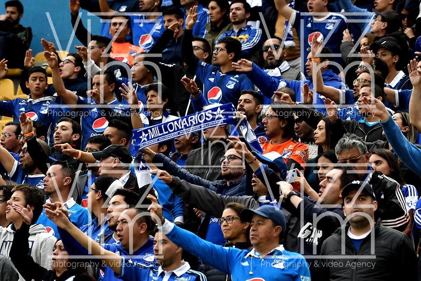 BOGOTÁ - COLOMBIA, 31–03-2019: Hinchas de Millonarios animan a su equipo durante partido de la fecha 12 entre Millonarios y Deportivo Independiente Medellín, por la Liga Águila I 2019, jugado en el estadio Nemesio Camacho El Campín de la ciudad de Bogotá. / Fans of Millonarios cheer for their team during a match of the 12th date between Millonarios and Deportivo Independiente Medellin, for the Aguila Leguaje I 2019 played at the Nemesio Camacho El Campin Stadium in Bogota city, Photo: VizzorImage / Luis Ramírez / Staff.