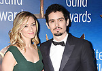 BEVERLY HILLS, CA - FEBRUARY 19: Actress/writer Olivia Hamilton (L) and director Damien Chazelle attend the 2017 Writers Guild Awards L.A. Ceremony at The Beverly Hilton Hotel on February 19, 2017 in Beverly Hills, California.