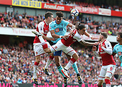 9th September 2017, Emirates Stadium, London, England; EPL Premier League Football, Arsenal versus Bournemouth; Joshua King of Bournemouth is intercepted by Laurent Koscielny and Hector Bellerin of Arsenal