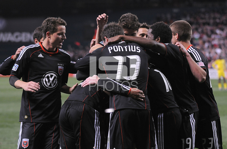 DC United forward Charlie Davies (9) celebrates his second goal of the game with team mates.  DC United defeated The Columbus Crew 3-1  at the home season opener, at RFK Stadium, Saturday March 19, 2011.