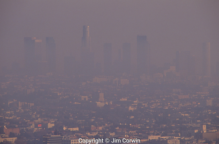 Los Angeles skyline, sunset view from Mulholland Drive,  barely visible because of the heavy smog in the air, Los angeles, California USA