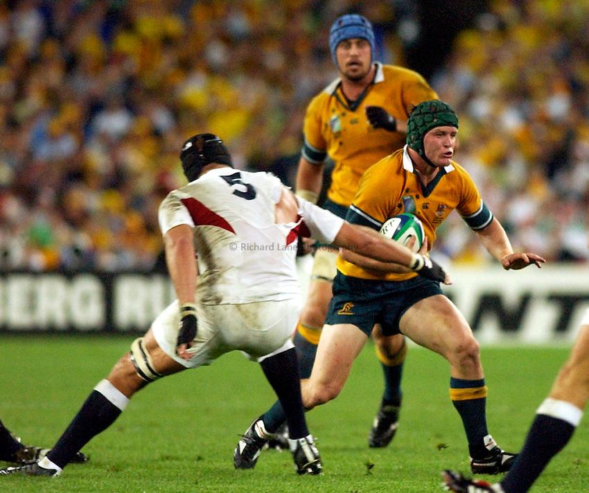 Photo: Steve Holland..Australia v England. Rugby World Cup Final, at the Telstra Stadium, Sydney. RWC 2003. 22/11/2003. .Elton Flatley breaks past Ben Kay.