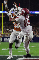 Arkansas Democrat-Gazette/BENJAMIN KRAIN --12/29/14--<br /> Arkansas receiver Demetrius Wilson makes a touchdown catch in front of Texas defender Duke Thomas in the 2nd quarter in the Texas Bowl Monday night at NRG Stadium in Houston.