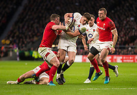 Englands' Owen Farrell is tackled by Wales' Scott Williams<br /> <br /> Photographer Bob Bradford/CameraSport<br /> <br /> NatWest Six Nations Championship - England v Wales - Saturday 10th February 2018 - Twickenham Stadium - London<br /> <br /> World Copyright &copy; 2018 CameraSport. All rights reserved. 43 Linden Ave. Countesthorpe. Leicester. England. LE8 5PG - Tel: +44 (0) 116 277 4147 - admin@camerasport.com - www.camerasport.com