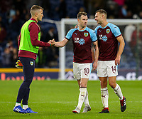 Burnley's Ben Gibson and Ashley Barnes celebrate after the final whistle with Adam Legzdins<br /> <br /> Photographer Alex Dodd/CameraSport<br /> <br /> UEFA Europa League - Third Qualifying Round 2nd Leg - Burnley v Istanbul Basaksehir - Thursday 16th August 2018 - Turf Moor - Burnley<br />  <br /> World Copyright © 2018 CameraSport. All rights reserved. 43 Linden Ave. Countesthorpe. Leicester. England. LE8 5PG - Tel: +44 (0) 116 277 4147 - admin@camerasport.com - www.camerasport.com