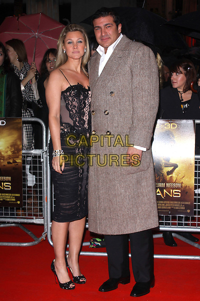 TAMER HASSAN & wife .World Premiere of 'Clash of the Titans' at the Empire cinema, Leicester Square, London, England, March 29th 2010. arrivals full length couple black lace dress brown coat trousers houndstooth peep toe shoes .CAP/AH.©Adam Houghton/Capital Pictures.