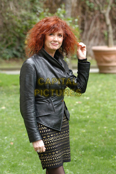 "SABINE AZEMA.Photocall for ""Peindre ou faire l'amour"" (To paint or make love) at the French Embassy, Rome, Italy..Ref: CAV.half length pattern dress gold black leather jacket.www.capitalpictures.com.sales@capitalpictures.com.© Capital Pictures."
