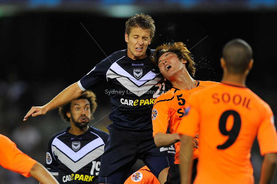 ADRIAN LEIJER of the Victory and PARK HYUNBEM of Jeju compete for a header during the AFC Champions League Group E match between the Melbourne Victory and Jeju United at Etihad Stadium in Melbourne, Australia.