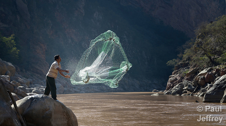 Tomas Rivero casts a net as he fishes on the Pilcomayo River outside of Villamontes, Bolivia. He is a leader of the Union of Pilcomayo River Fishers, and an advocate for cleaning up the river, which has been plagued by contamination from upstream mining and road construction. This portion of the river is inside the protected Aguaragüe National Park and Integrated Management Natural Area.
