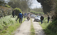 somehow a Team One Pro Cycling teamcar got stuck in the ditch alongside the gravel road just a minute before the peloton had to come through<br /> <br /> 33th Tro Bro L&eacute;on 2016