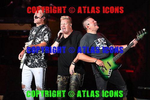 WEST PALM BEACH, FL - JULY 21: Joe Don Rooney, Gary LeVox and Jay DeMarcus of Rascal Flatts perform at The Coral Sky Amphitheatre on July 21, 2018 in West Palm Beach Florida. Credit Larry Marano © 2018
