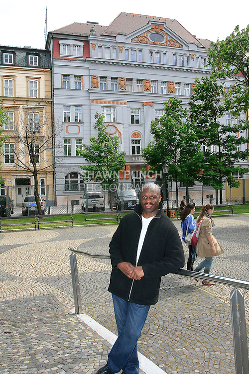 Me standing on bridge in Hviezdoslav Square, Bratislava, with the US Embassy in the background.