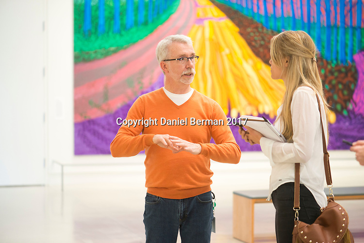 Curator Greg Bell speaks with writer Alex Moji ahead of the opening of the new Color & Pattern show on display at Pivot Art + Culture through July 23, 2017. The show boldly explores the variety of styles by which artists have interpreted color and pattern - from the abstract to the representational. Photo by Daniel Berman