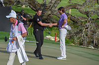 Matthew Wallace (ENG) shakes hands with Aaron Baddeley (AUS) on 18 following round 4 of the Arnold Palmer Invitational at Bay Hill Golf Club, Bay Hill, Florida. 3/10/2019.<br /> Picture: Golffile | Ken Murray<br /> <br /> <br /> All photo usage must carry mandatory copyright credit (© Golffile | Ken Murray)