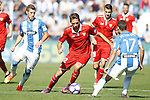CD Leganes' Ruben Perez (l) and Victor Diaz (r) and Sevilla FC's Franco Vazquez during La Liga match. October 15,2016. (ALTERPHOTOS/Acero)