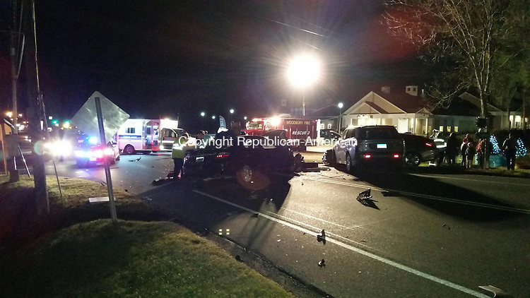 WOODBURY, CT:04 Dec. 2015:120415BB01:WOODBURY ---- Emergency services personnel respond to a four-vehicle crash just before Dottie's Diner on Route 6 Friday evening. Two people were hospitalized with minor injuries. Bill Bittar Republican-American