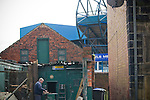 A man sawing wood in a workshop behind the the north stand pictured before Sheffield Wednesday take on Peterborough United in a Coca-Cola Championship match at Hillsborough Stadium, Sheffield. The home side won by 2 goals to 1 giving Alan Irvine his third straight win since taking over as Wednesday's manager.