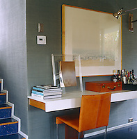 A cantilevered console table in the open-plan living area serves as reading table, desk and cocktail cabinet