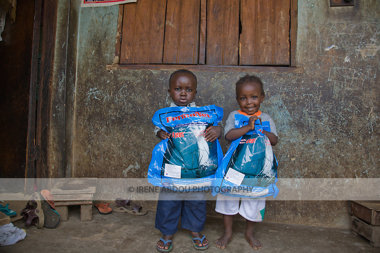 Children holding Permanet long lasting insecticide treated mosquito nets in the Garki area of Abuja, Nigeria