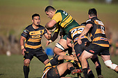 Multiple Bombay defenders try to stop Cameron Skelton's run. Counties Manukau Premier Club Rugby game between Bombay and Pukekohe, played at Bombay on Saturday June 30th 2018.<br /> Bombay won the game 24 - 14 after leading 24 - 0 at halftime.<br /> Bombay 24 - Sepuloni Taufa, Tulele Masoe, Chay Mackwood, Liam Daniela tries, Ki Anufe 2 conversions.<br /> Pukekohe Mitre 10 Mega 14 - Joshua Baverstock, Gregor Christie tries; Cody White 2 conversions.<br /> Photo by Richard Spranger.
