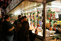 Activities along Mulberry Street on Tuesday, Sept. 19th. 2007 for the celebration of the 80th. San Gennaro Festival. The 11 day festival is presented by (Figli Di San Gennaro) Children of San Gennaro and runs through Sept. 23rd. 2007. Photo by Errol Anderson.