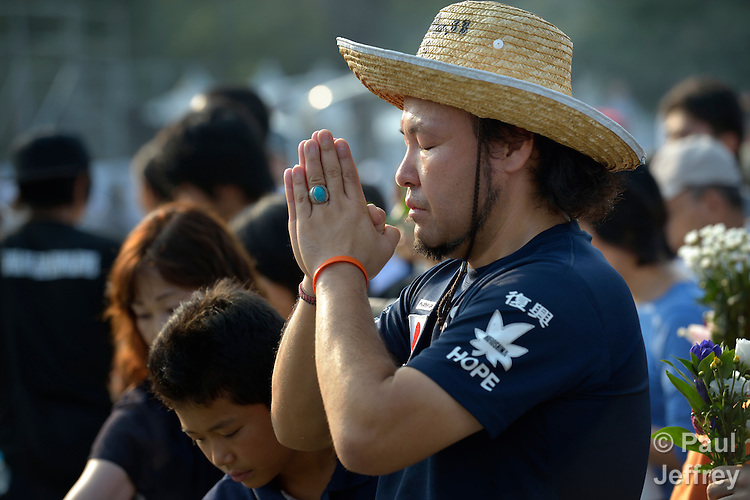 A man prays on August 6, 2015, at a memorial in Hiroshima, Japan, that commemorates the victims of the atomic bombing of the city by the United States in 1945.