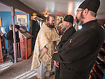 First Monastic Liturgy, St. Silhouan Monastery, Columbia, California.<br /> <br /> Archimandrite Irinei greets two monks.