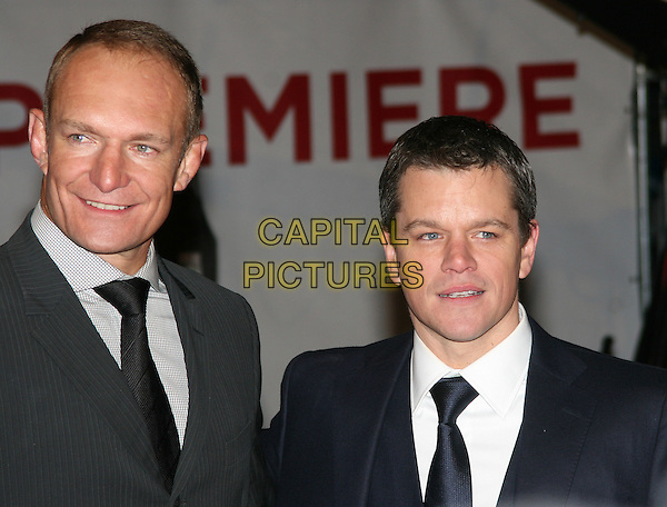 "FRANCOIS PINEAAR & MATT DAMON .Attending the ""Invictus'"" UK Film Premiere at the Odeon West End cinema, Leicester Square, London, England, January 31st, 2010..arrivals portrait headshot black grey gray tie suit white shirt .CAP/JIL.©Jill Mayhew/Capital Pictures"