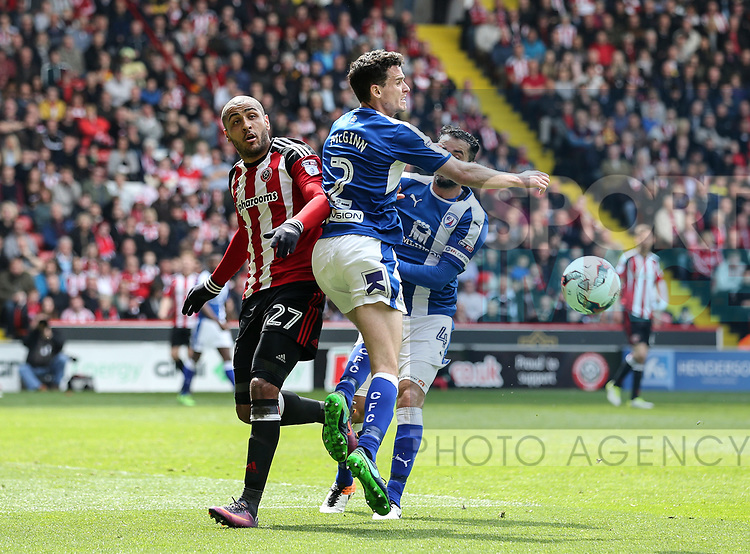 Sheffield United's Leon Clarke tussles with Chesterfield's Paul McGinn during the League One match at Bramall Lane, Sheffield. Picture date: April 30th, 2017. Pic David Klein/Sportimage