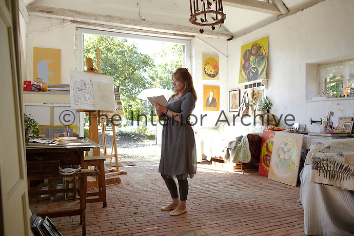 Sheila Scholes photographed at work in the studio of her house in Norfolk