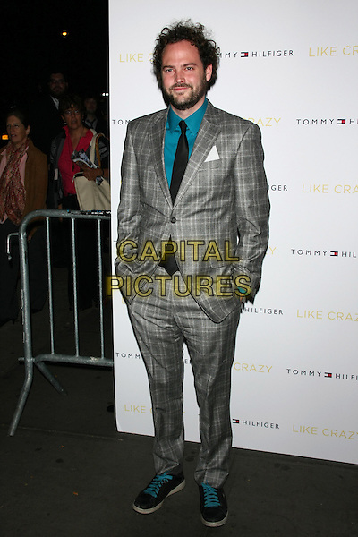 """Drake Doremus .The New York Premiere of """"Like Crazy"""" at the Landmark Sunshine Cinema, New York, NY, USA..October 18th, 2011.full length grey gray check suit hands in pockets blue shirt black tie beard facial hair .CAP/LNC/TOM.©TOM/LNC/Capital Pictures."""
