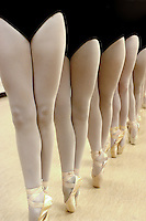 Close up photograph of the symmetrical alignment of ballet dancing girls at a rehearsal.