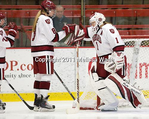 Hilary Crowe (Harvard - 8), Laura Bellamy (Harvard - 1) - The visiting Dartmouth College Big Green defeated the Harvard University Crimson 3-2 on Wednesday, November 23, 2011, at Bright Hockey Center in Cambridge, Massachusetts.