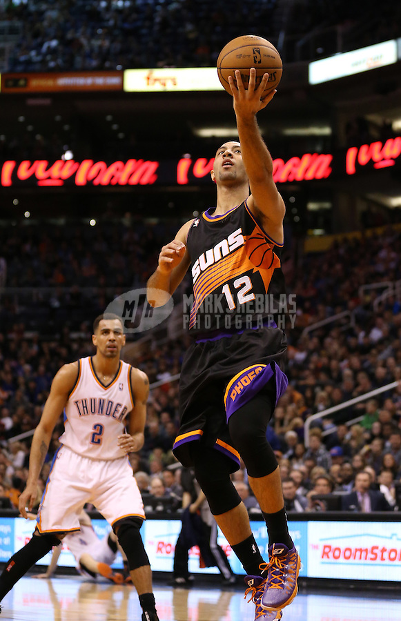 Feb. 10, 2013; Phoenix, AZ, USA: Phoenix Suns guard Kendall Marshall (12) lays up the ball in the second half against the Oklahoma City Thunder at the US Airways Center. Mandatory Credit: Mark J. Rebilas-