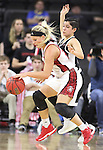 SIOUX FALLS, SD: MARCH 5: Madison McKeever #23 of South Dakota drives into pressure from Amber Vidal #5 of Omaha during the Summit League Basketball Championship on March 5, 2017 at the Denny Sanford Premier Center in Sioux Falls, SD. (Photo by Dick Carlson/Inertia)