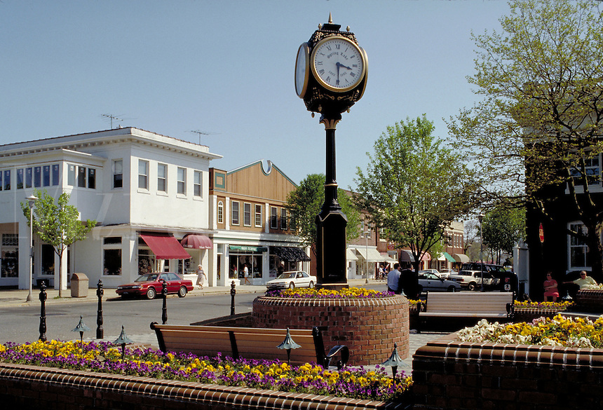 Clock and garden in small town center. urban design, cityscape, ornamental architecture, timepiece. Spring Lake New Jersey.
