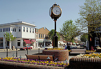 Clock and garden in small town center. urban design, cityscape, ornamental architecture, timepiece. Spring Lake New Jersey.