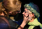 Kelly Graver gets her face painted by Tabi Keeling at the Brewery Arts Center stop of the Blinky Man Halloween bike ride around the west side of Carson City, Nev., on Wednesday, Oct. 31, 2013.<br /> Photo by Cathleen Allison/Nevada Photo Source
