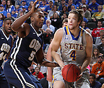 SIOUX FALLS, SD - MARCH 5:  Jake Bittle #4 of South Dakota State looks to pass against Brandon Conley #5 of Oral Roberts in the 2016 Summit League Tournament. (Photo by Dick Carlson/Inertia)