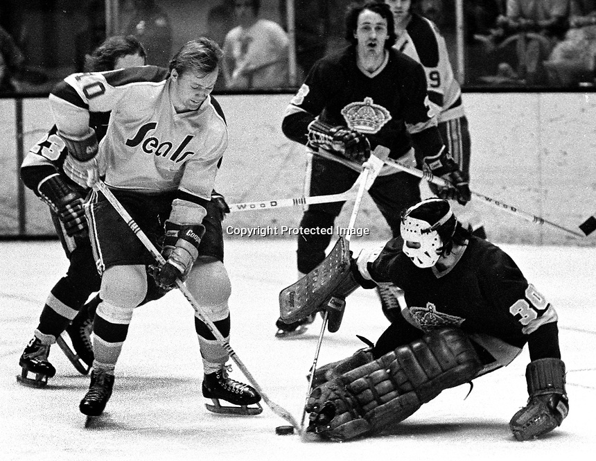 Seals Stan Gilbertson tries to score against the Los Angles Kings goalie Rogie Vachon, and Bery Long.(1971 photo by Ron Riesterer)