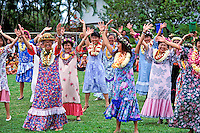 Schoolteachers from Aikahi Elementary School, in Kailua, Oahu dance a hula togther for May Day, while wearing leis and laughing.