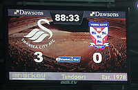 Pictured: 3-0 the final score on the scoreboard Tuesday 25 August 2015<br /> Re: Capital One Cup, Round Two, Swansea City v York City at the Liberty Stadium, Swansea, UK.