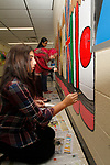 WATERBURY, CT - 08 OCTOBER 2017 -101417JW13.jpg -- West Side Middle School students Trinity Palmer, Khadija Nawan and Alyssa Bisram put the finishing touches on a wall mural during the school's 9th Annual Community Day Saturday afternoon. Jonathan Wilcox Republican-American